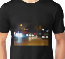 Abstract blurry spots of light in the night city street scene Unisex T-Shirt