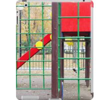 Empty children's playground and a slide in the park iPad Case/Skin
