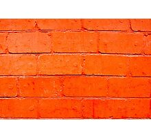 Red background of bricks with a layer of paint close-up Photographic Print