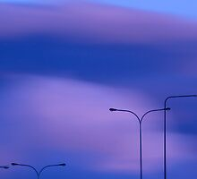 Sky and lightpoles by Tommi Rautio