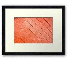 Red background of bricks on a diagonal image with a layer of paint Framed Print