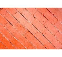 Red background of bricks on a diagonal image with a layer of paint Photographic Print