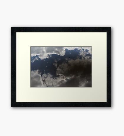 Reflecting on the sky above Framed Print