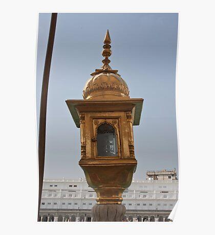 Golden lamp inside the Golden Temple in Amritsar Poster
