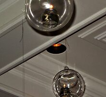 Glass Globes Hanging From the Ceiling With Oil Lamps Inside by Jane Neill-Hancock