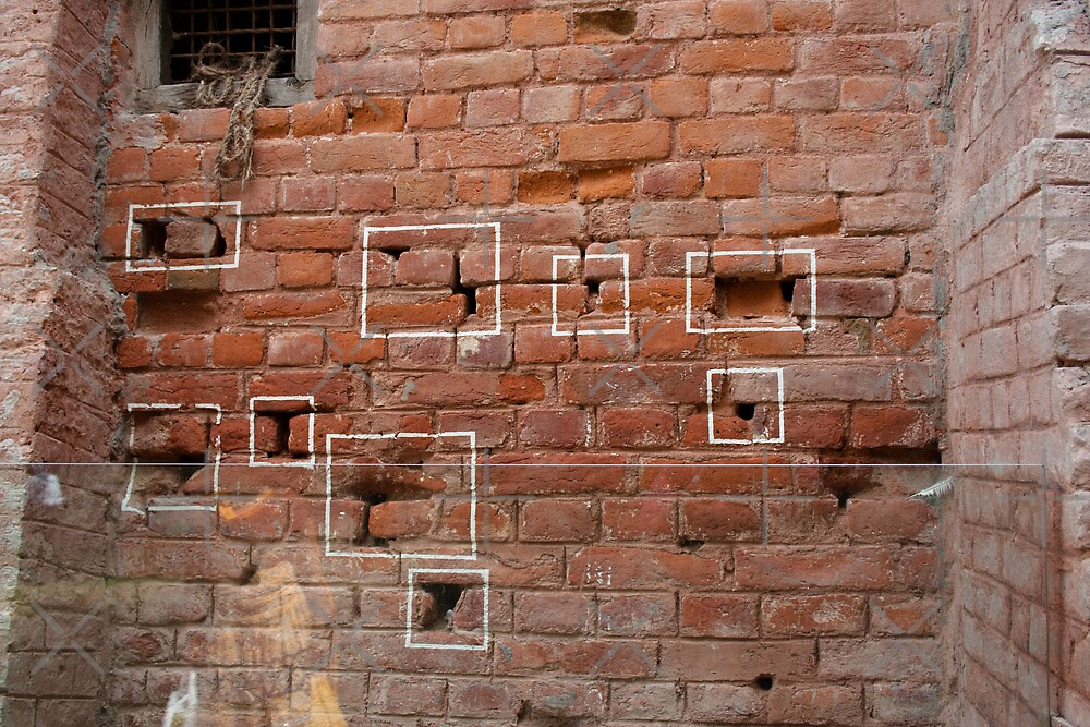 Marks on the wall where bullets struck by ashishagarwal74