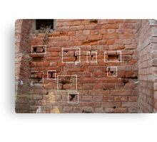 Marks on the wall where bullets struck Canvas Print