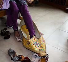 Trying on a very large decorated shoe by ashishagarwal74