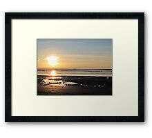 Watery sunset Framed Print