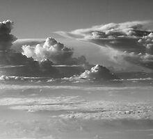 Thunderheads over a sea of clouds  by Roupen  Baker