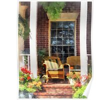 Wicker Chair With Striped Pillow Poster