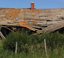 Abandoned old house on the prairie by Jim Sauchyn