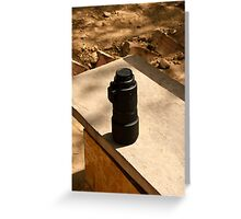 Nikon zoom lens on a stone bench Greeting Card