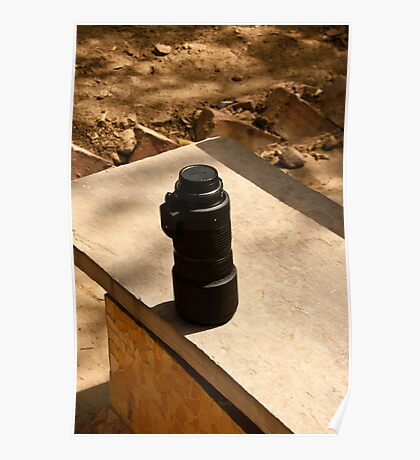 Nikon zoom lens on a stone bench Poster