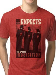 Nobody expects them! Tri-blend T-Shirt