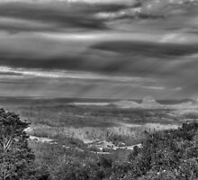 sun showers over the glasshouse mountains b&w by warren dacey
