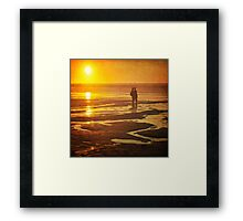 Couple on a sunset beach Framed Print