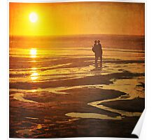Couple on a sunset beach Poster