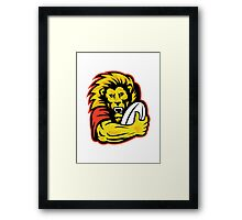 rugby player lion holding ball Framed Print