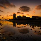 Sunset behind reflected buildings by Ralph Goldsmith