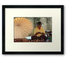 The Umbrella Maker Framed Print