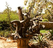 A wooden sculpture inside a garden. by ashishagarwal74