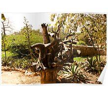 A wooden sculpture inside a garden. Poster