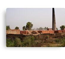 Brick kiln and pile of bricks Canvas Print