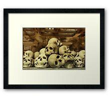 A Pile of Skulls Framed Print