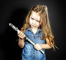 Cute little girl with gas spanner in her hands by Alexander Sorokopud