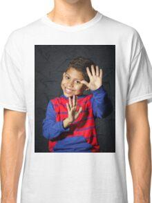 Emotional little black afro-american boy posing in studio Classic T-Shirt
