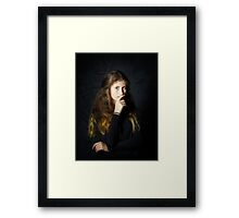 Cute young armenian girl posing in studio isolated on black Framed Print