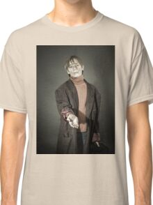 Young actor showing beggar. Old coat and dirty face. Classic T-Shirt