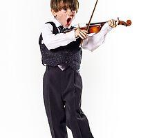 Red-haired preschooler boy with violin, music education by Alexander Sorokopud