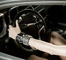 Girl at the luxury sport car wheel by Alexander Sorokopud