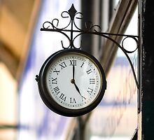 Vintage style street clock view. Center of Budapest, Hungary. by Alexander Sorokopud