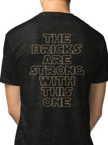 THE BRICKS ARE STRONG WITH THIS ONE Tri-blend T-Shirt