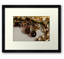 3 hanging semi-precious stones attached to a green and gold necklace Framed Print