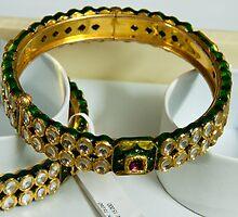 Beautiful green and purple covered gold bangles with semi-precious stones inlaid by ashishagarwal74