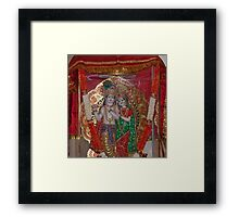 Statue of Lord Krishna and Radha inside a glass case with a cloth cover Framed Print