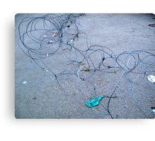 Concertina wire along the ground barring entry to a location Canvas Print