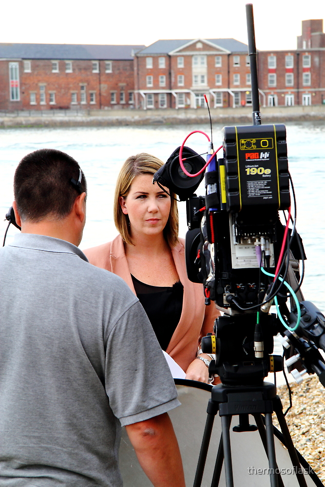 BBC news reporter on location by thermosoflask