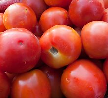 A pile of luscious bright red tomatoes by ashishagarwal74