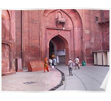 People entering the entrance gate to the red colored Red Fort in New Delhi, India Poster