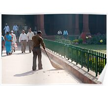 Sweeping the path in front of one of the buildings inside the Red Fort Poster