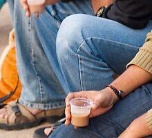 Group of teenagers sitting and drinking tea by ashishagarwal74