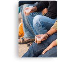 Group of teenagers sitting and drinking tea Canvas Print