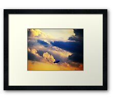 Dirigible through clouds over New York City Framed Print