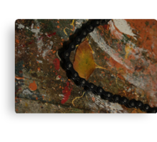 Early Leaf that fell by Garage Door Chain Canvas Print
