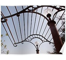 A metal structure, part of the lamp shade arrangement in a garden Poster